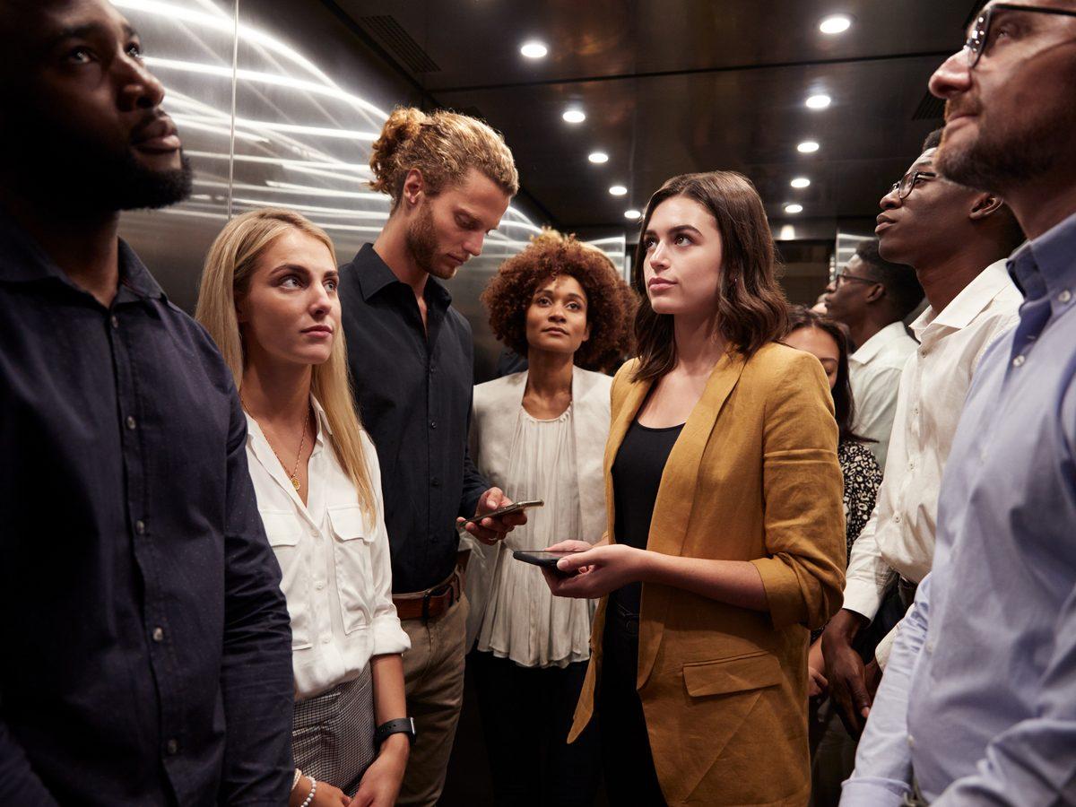Elevator full of hip employees