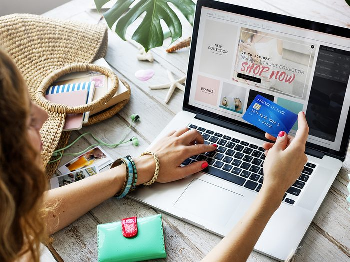 Online shopping - Woman on laptop with credit card