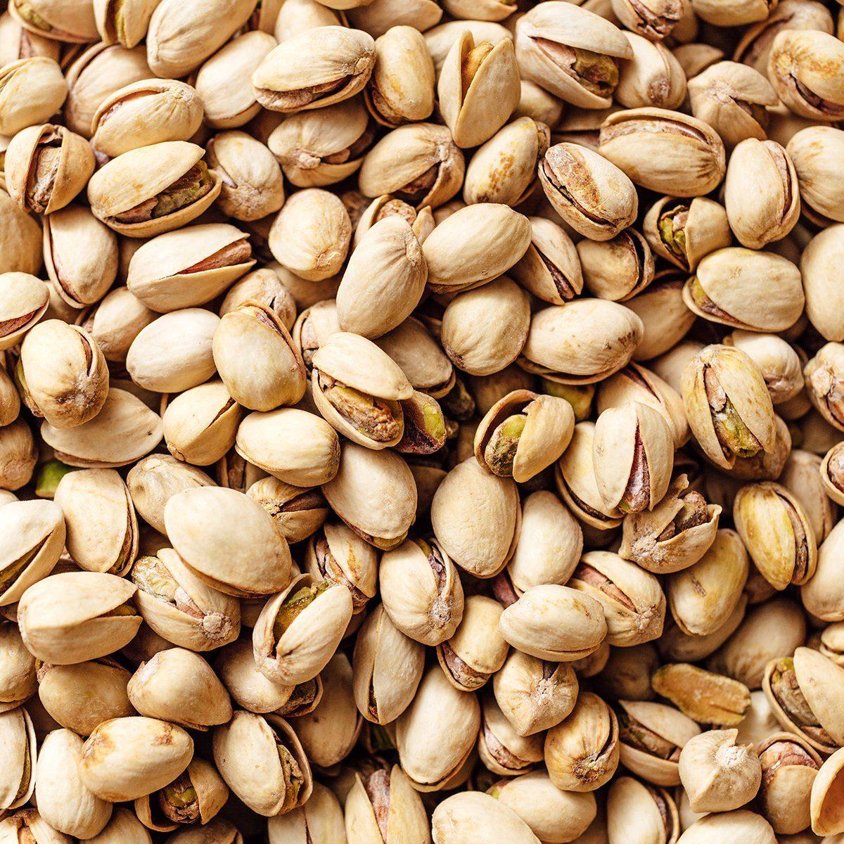 Pistachio texture. Nuts. Close-up of pistachio. Salted pistachio - beer snack.