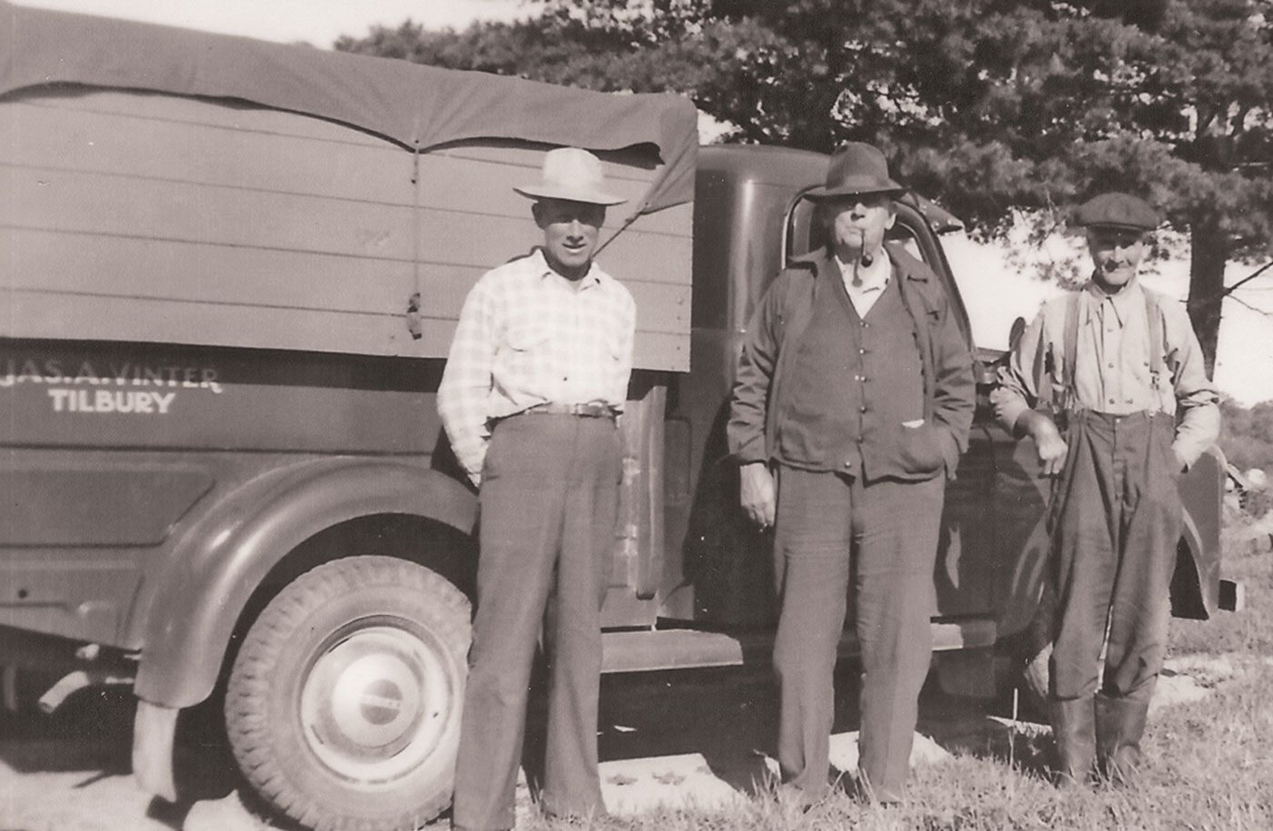 Millie's dad (Jim Vinter, white hat), grandfather Earl Roadhouse and great uncle William Thackwray alongside the 1950 Dodge Ram