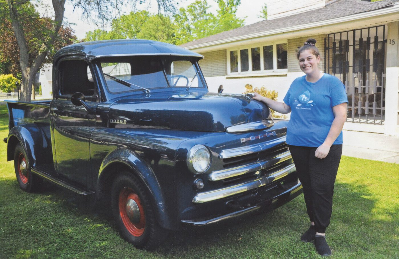 MIllie's granddaughter Jaclyn with the restored Dodge