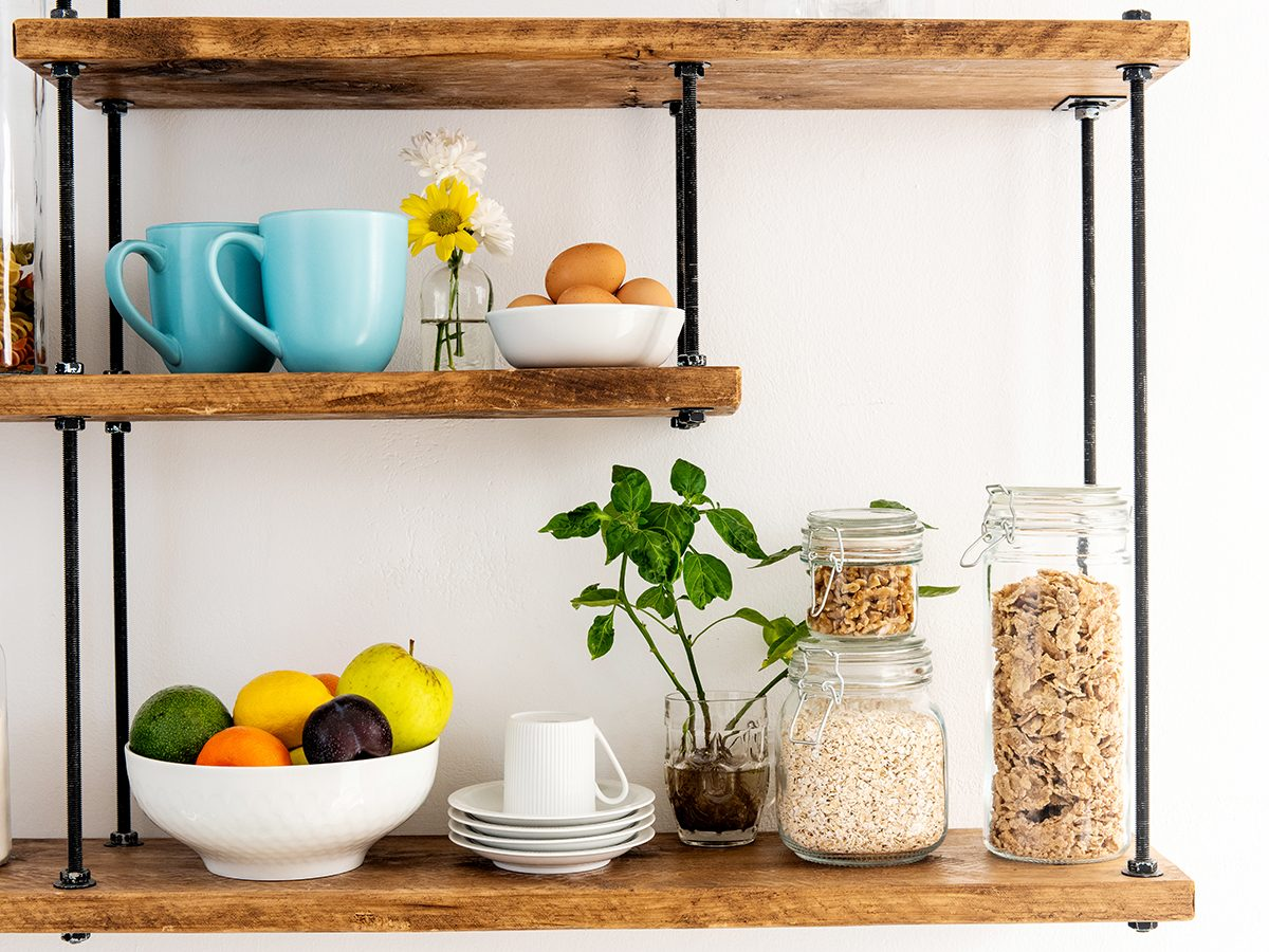 Assortment of glass jars with cereals on shelves