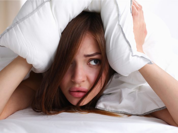Woman waking up stressed out