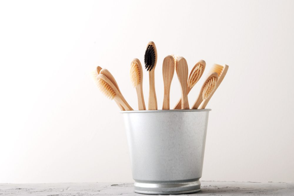 many bamboo teeth brush on minimalistic backgroud. zero waste concept