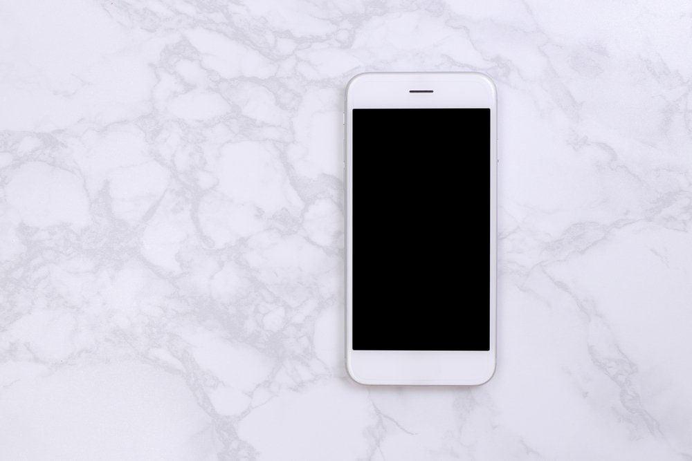 White mockup smartphon on marble background