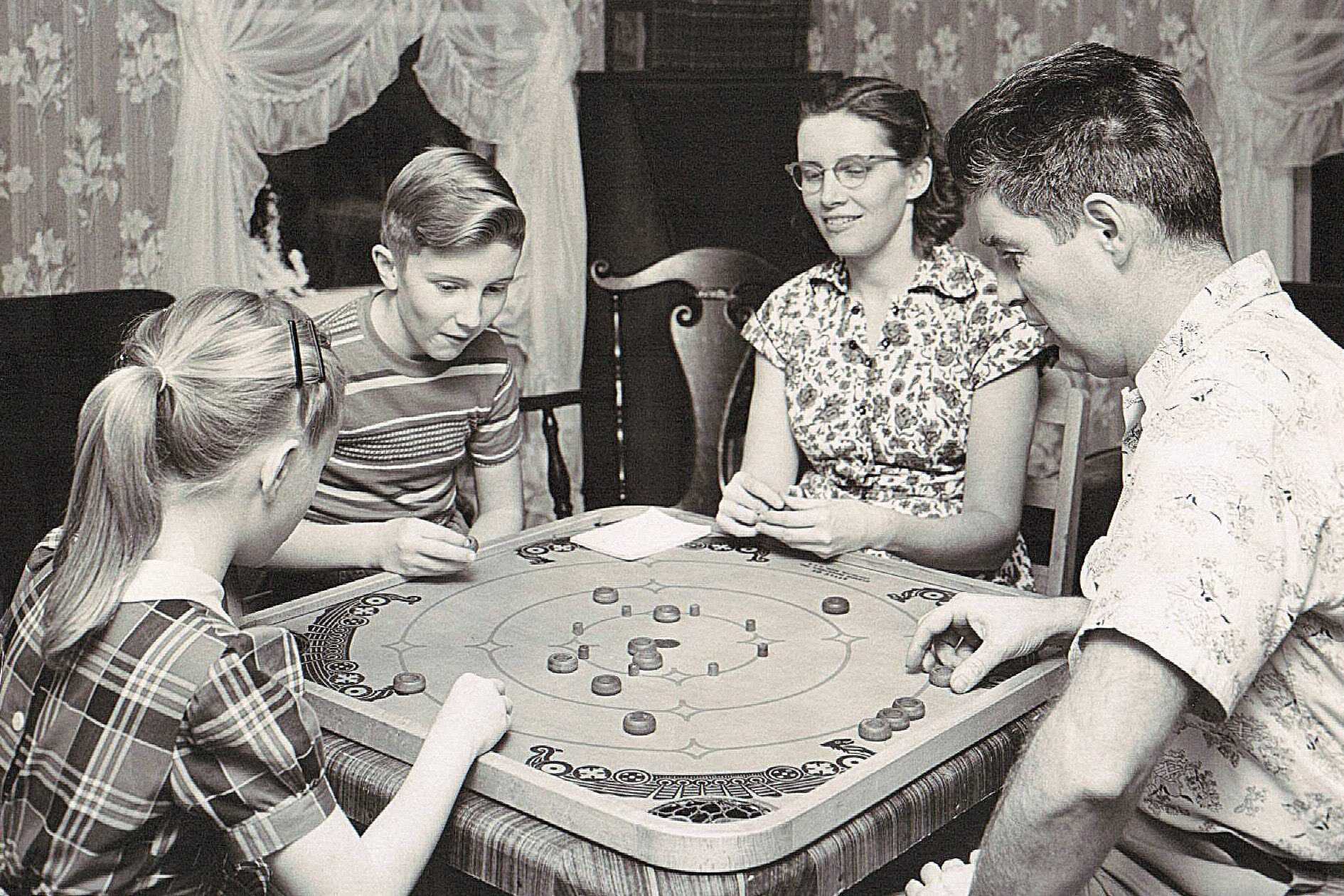 family playing board games vintage photo