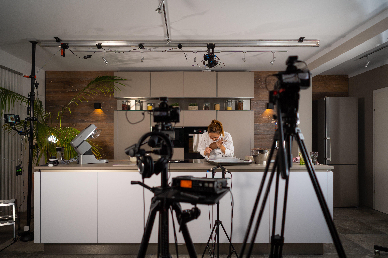tv set studio kitchen female cook preparing cookies