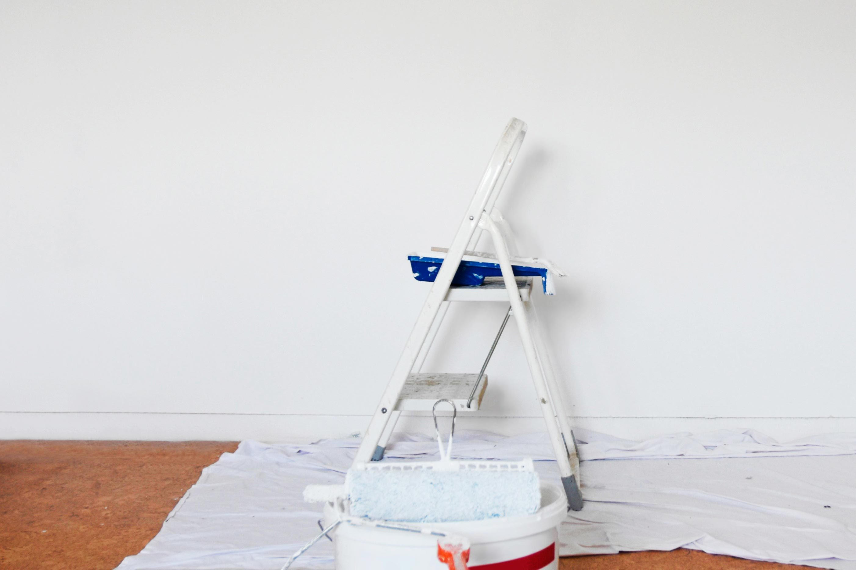 step ladder and drop cloth and paint
