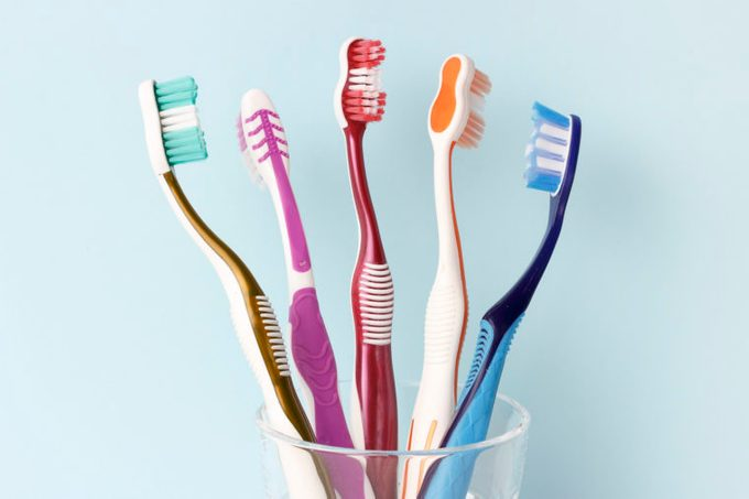 toothbrushes in cup