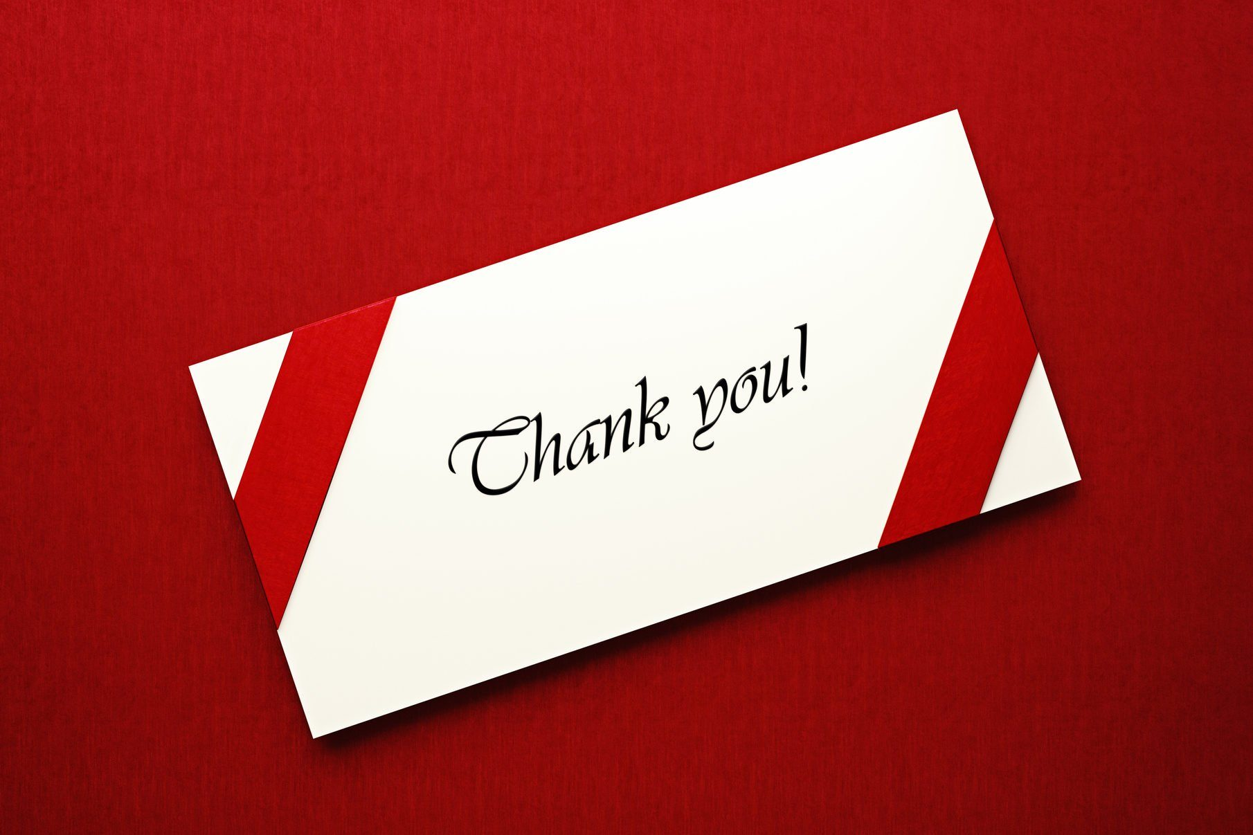 White Thank You Note on Red Background