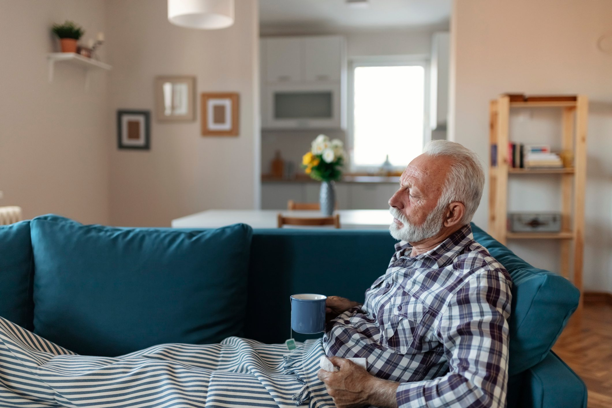 man sick on couch shortness of breath