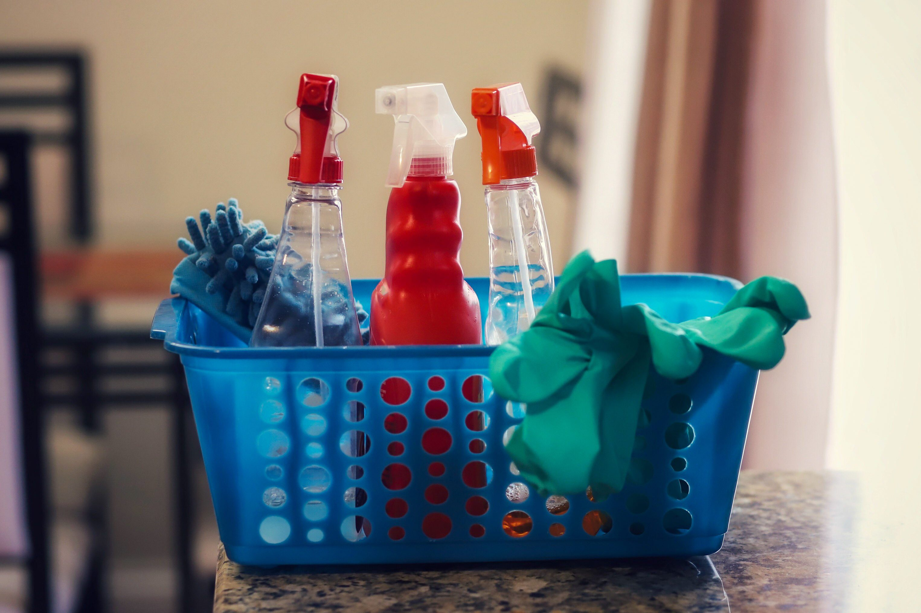 Cleaning supplies sitting on a kitchen counter