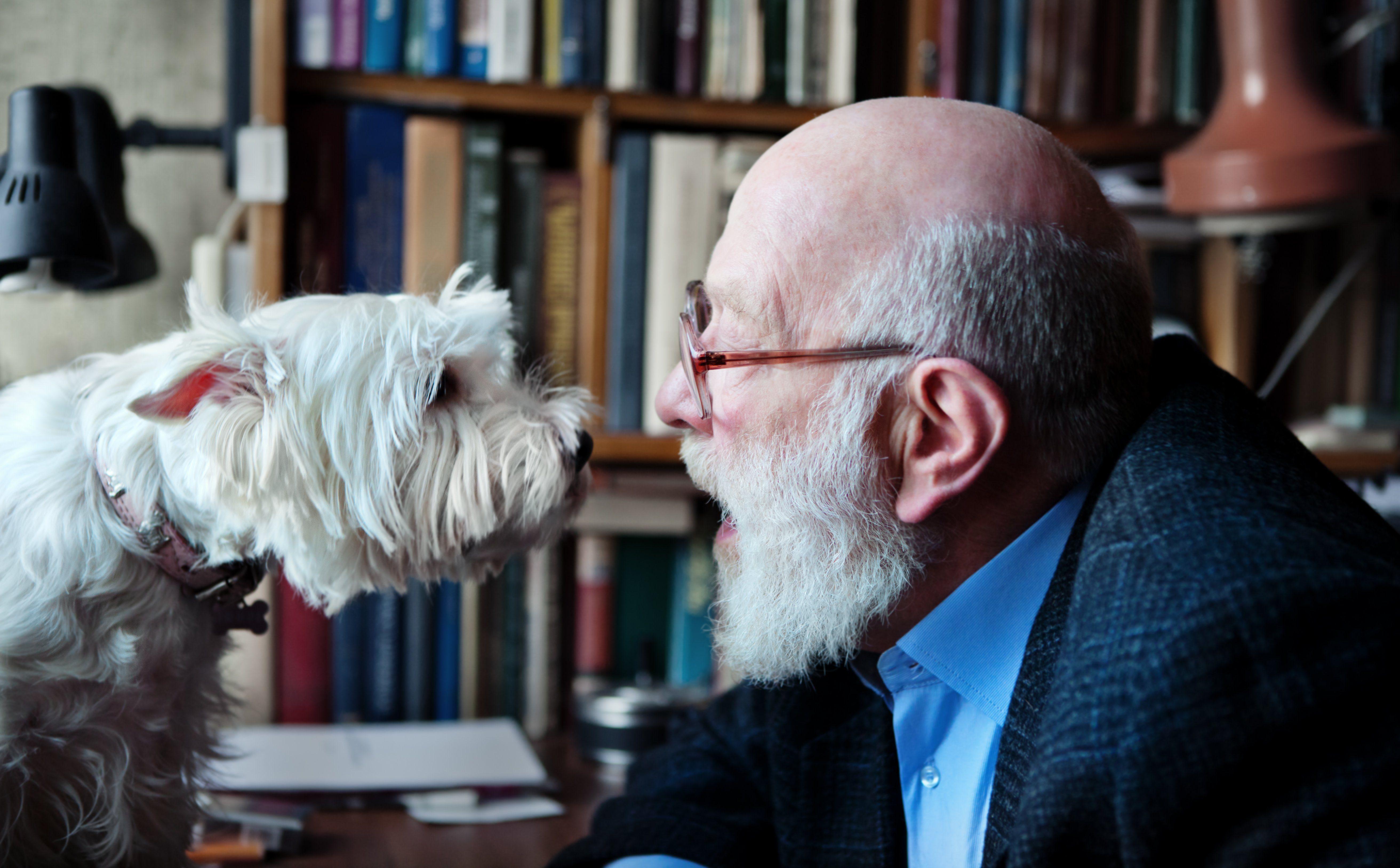 Senior Adult Man With His Dog
