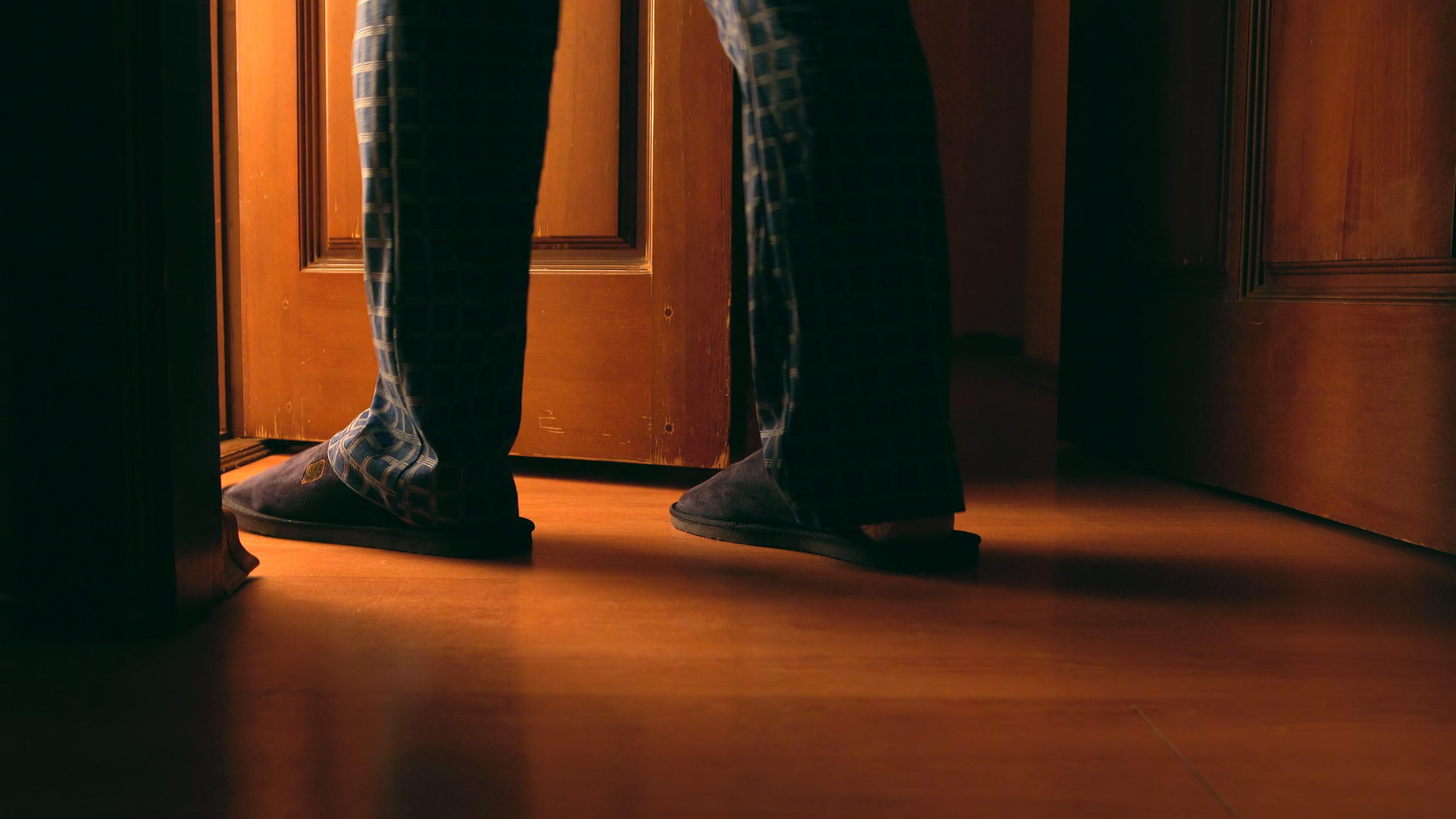 Adult man walks to a bathroom at the night elderly