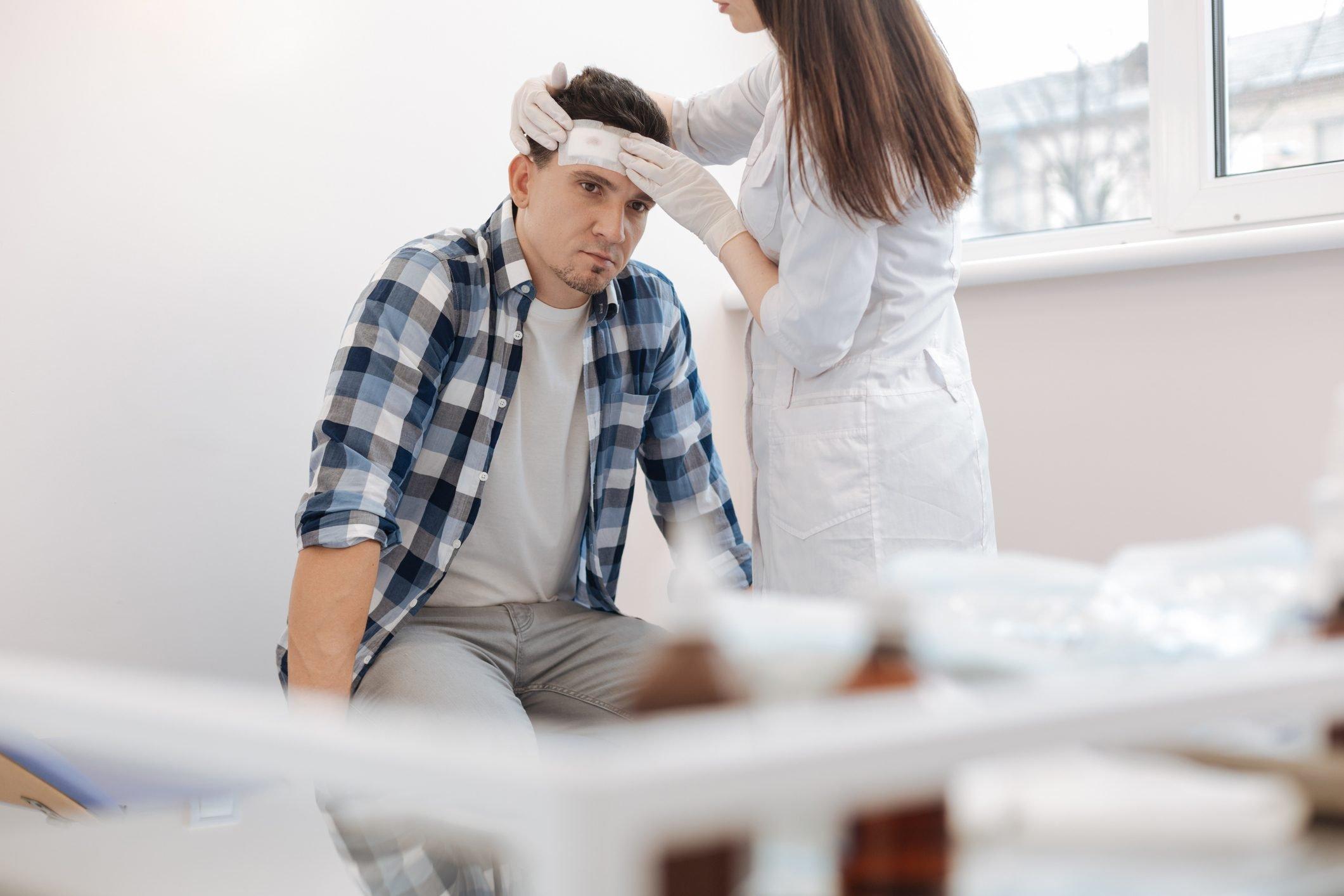 doctor evaluating patient head injury