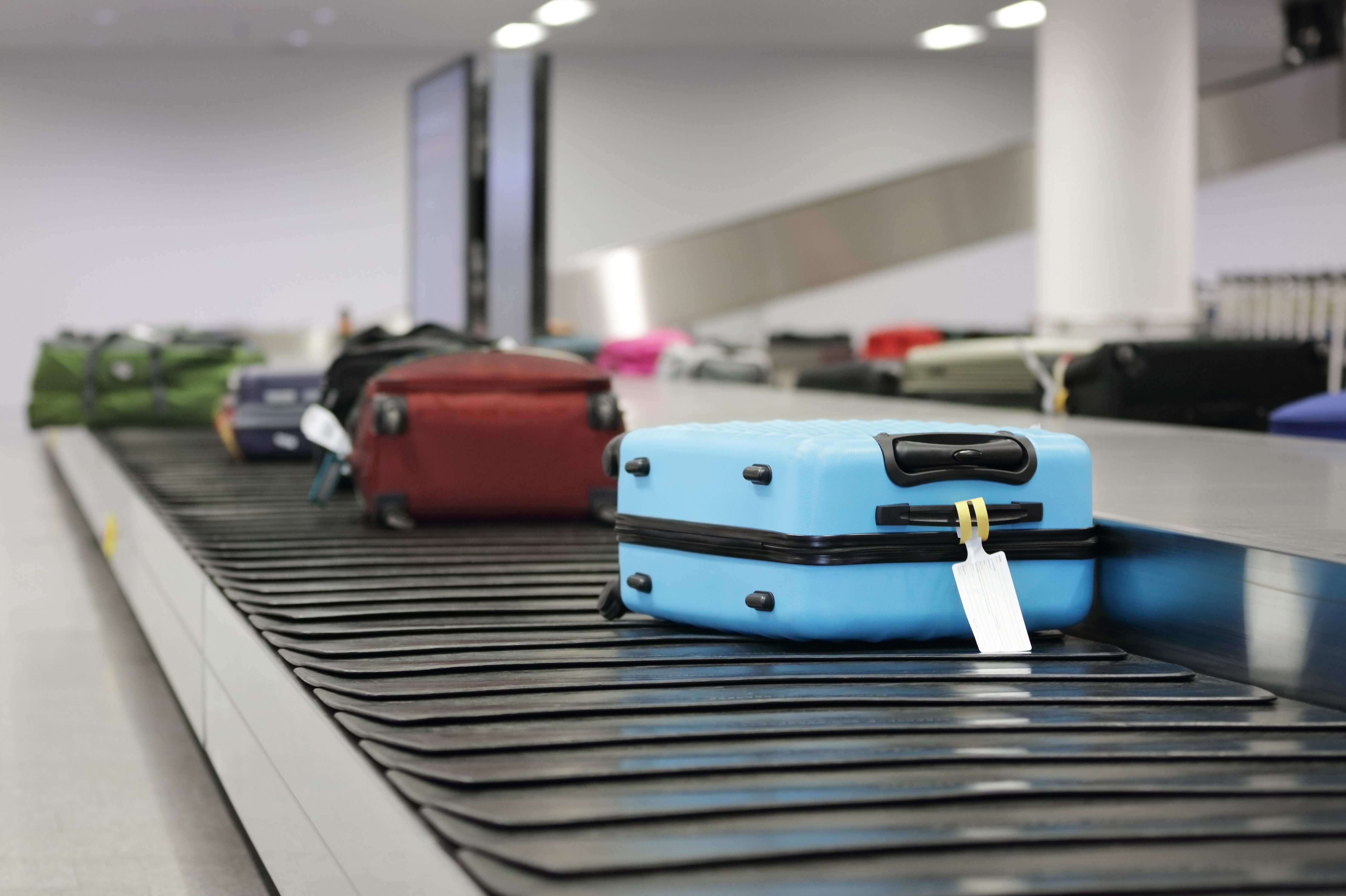 Suitcase or luggage on conveyor belt in the airport