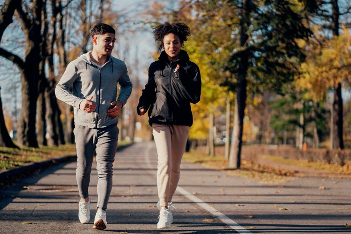 Benefits of walking - sporty couple in the park
