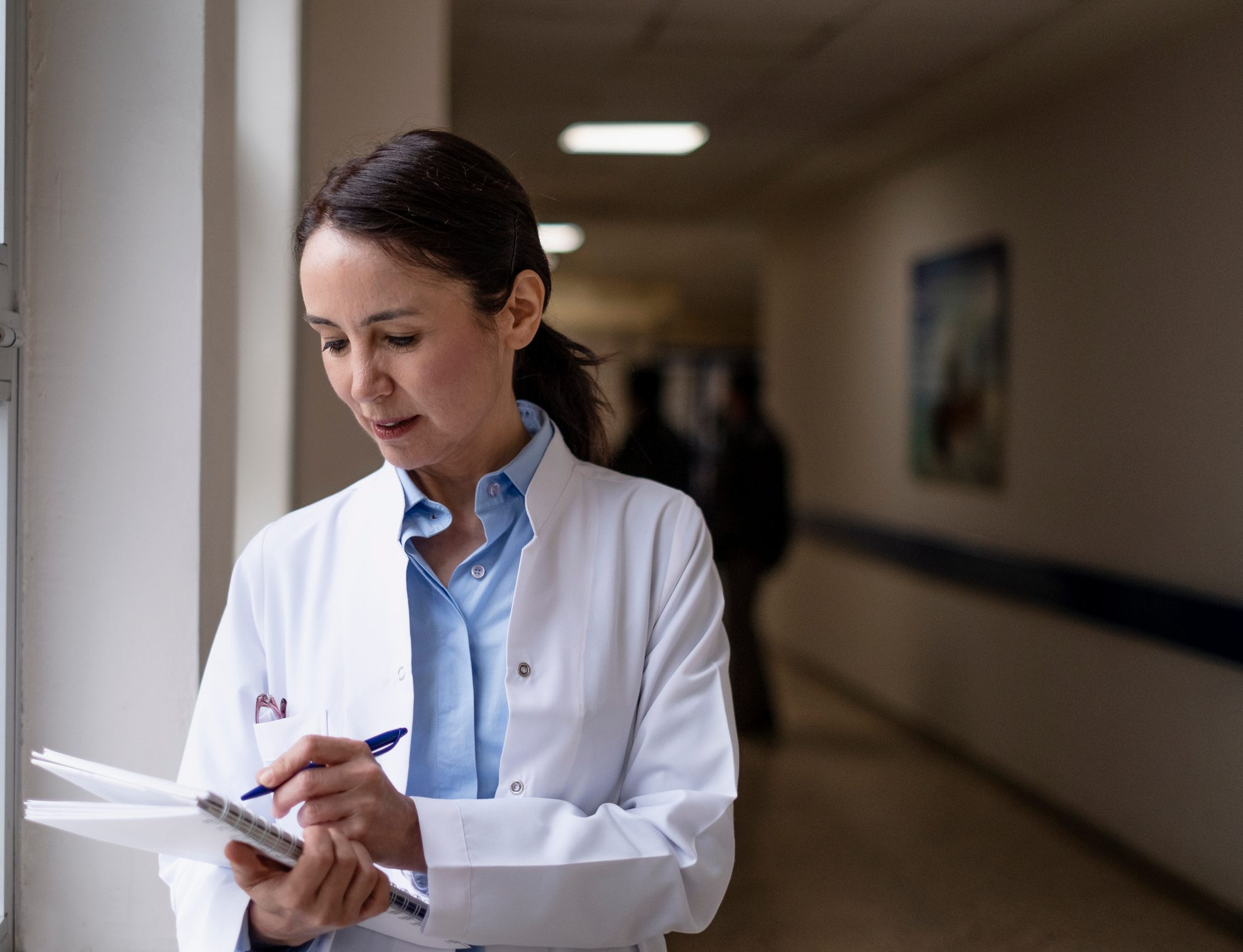 female doctor writing down information