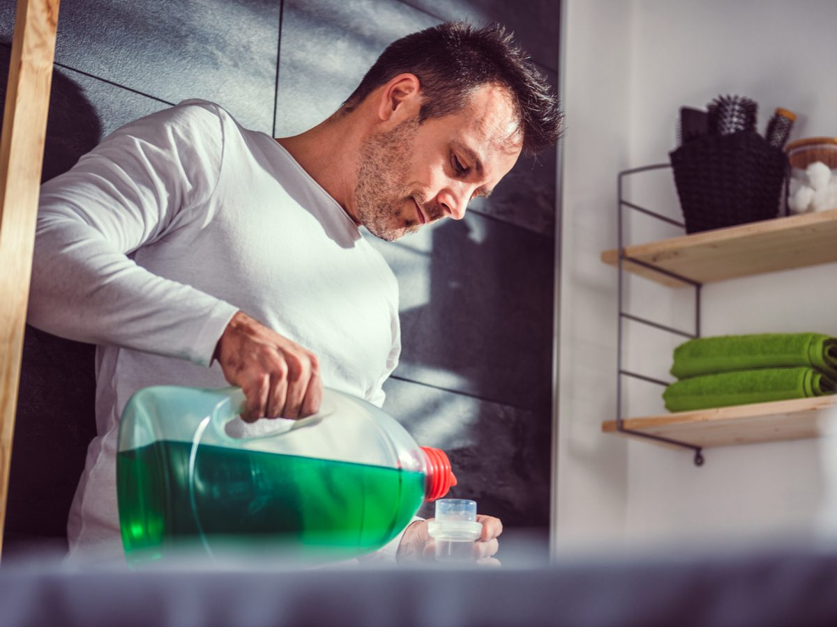 Man pouring detergent for laundry