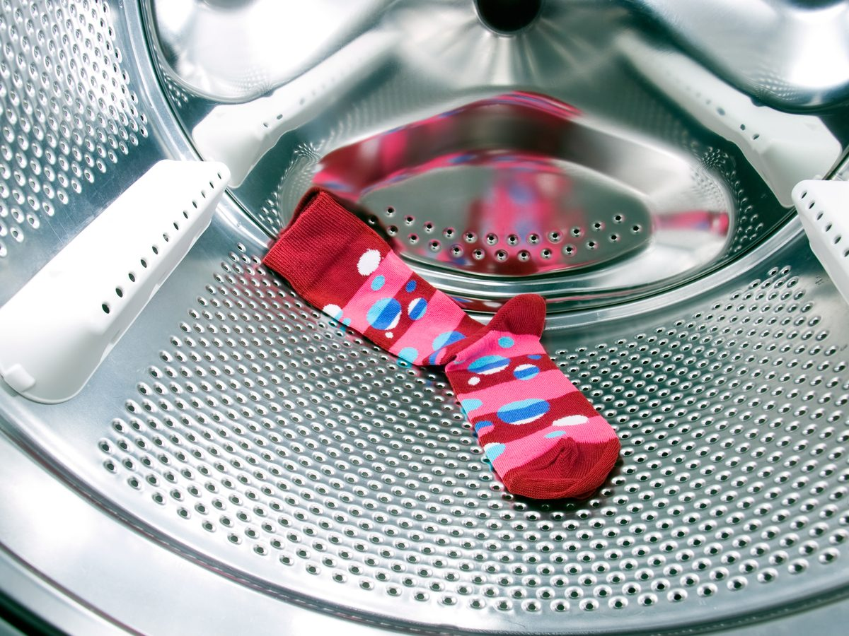 Vibrant, colourful sock in washing machine