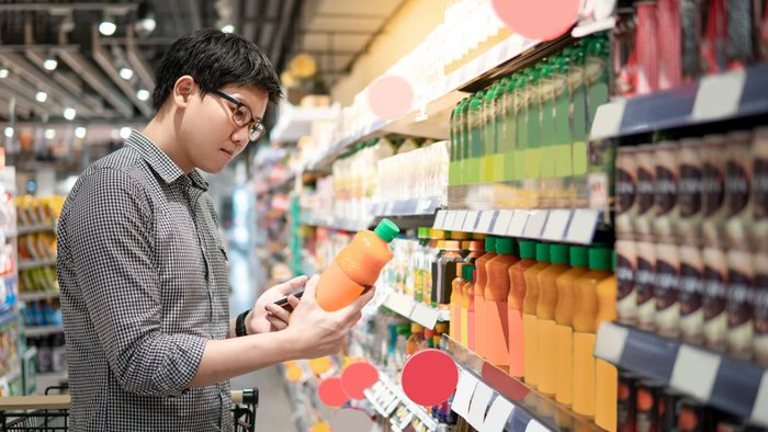 Produce section - Man choosing juice
