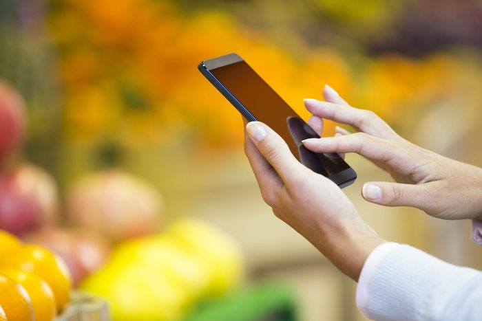 Produce section - Checking phone for produce recalls