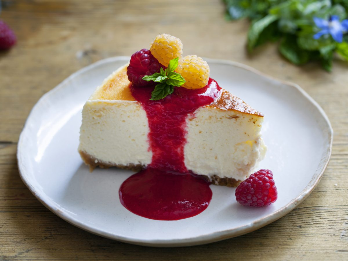 Raspberry coulis on cheesecake