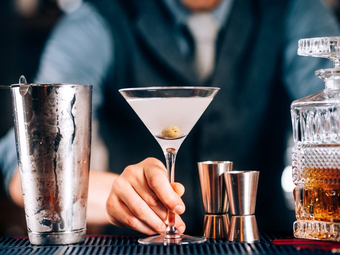 Bartender serving up a Dry Martini