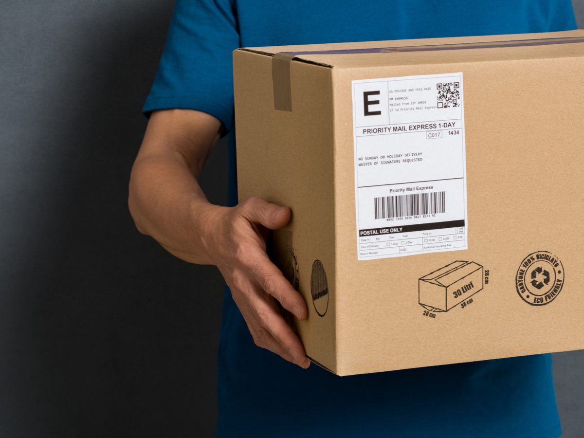 Courier holding cardboard box