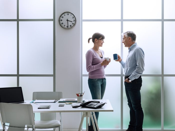 Two coworkers chatting