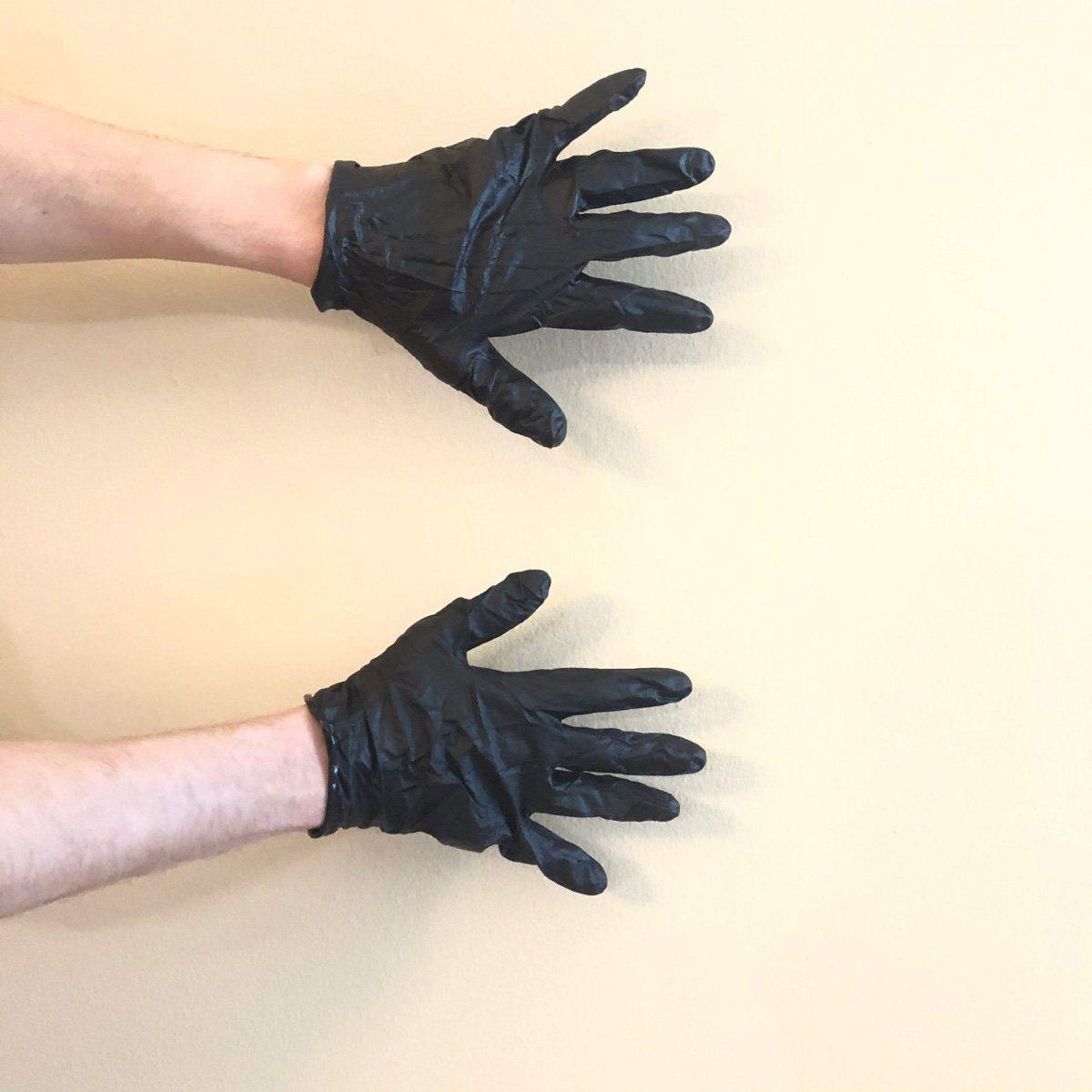 Hands with black nitrile gloves