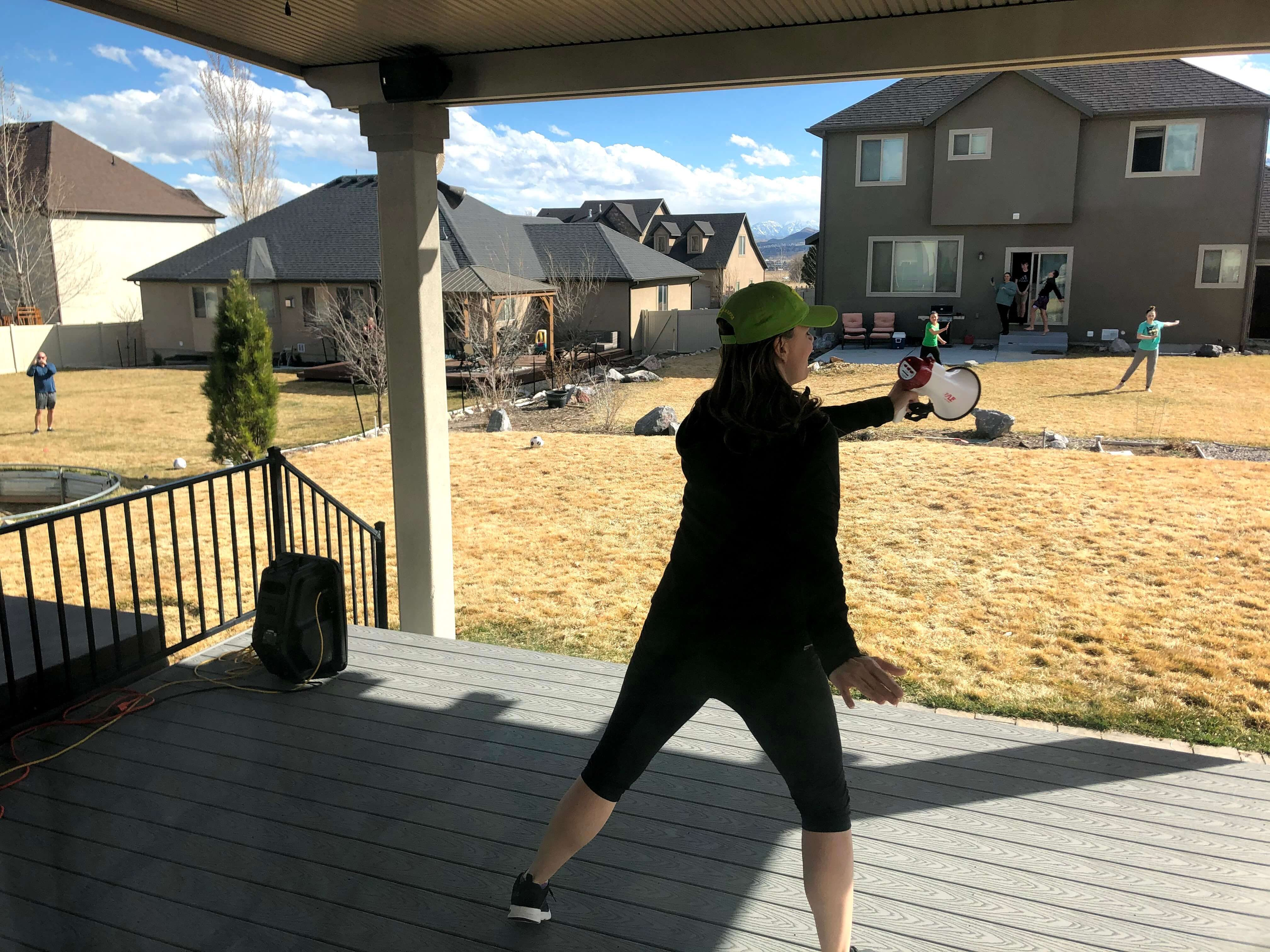Woman exercising on her porch during COVID-19 pandemic quarantine period