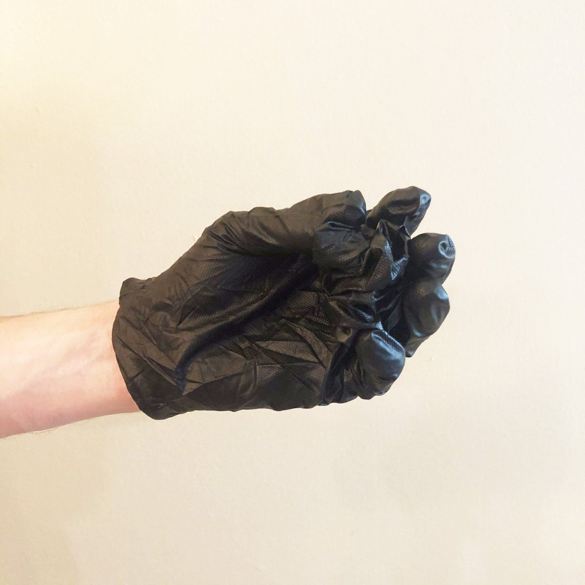 Step 3 of removing gloves
