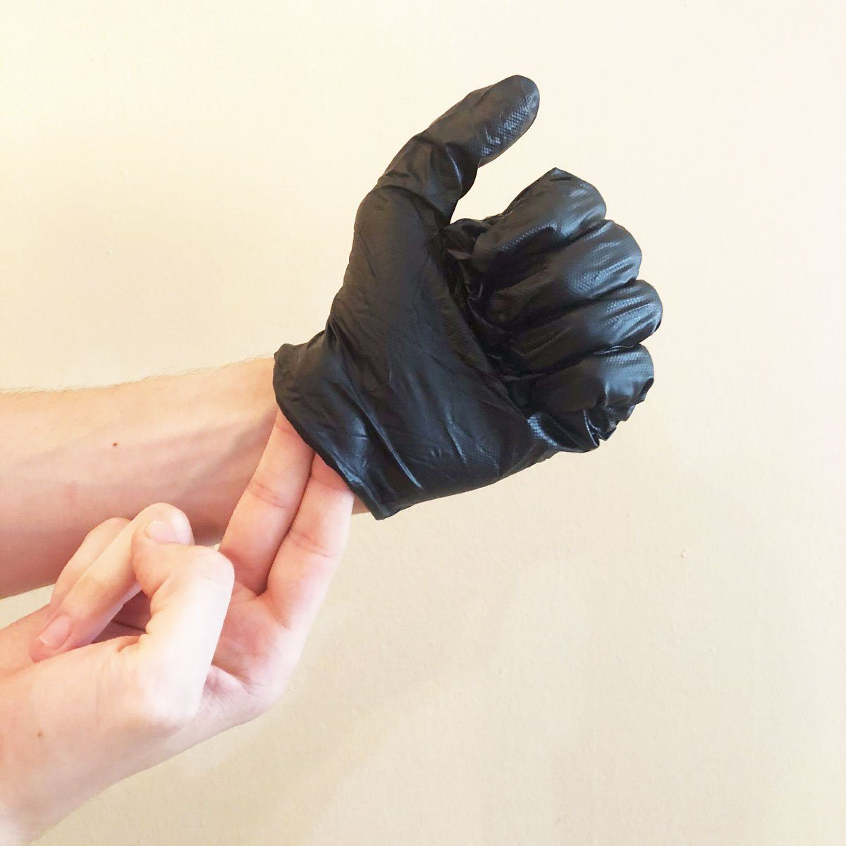 Step 4 of removing gloves