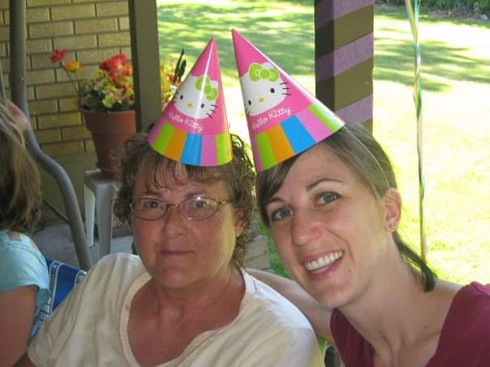 Janette Kudin and mother in party hats