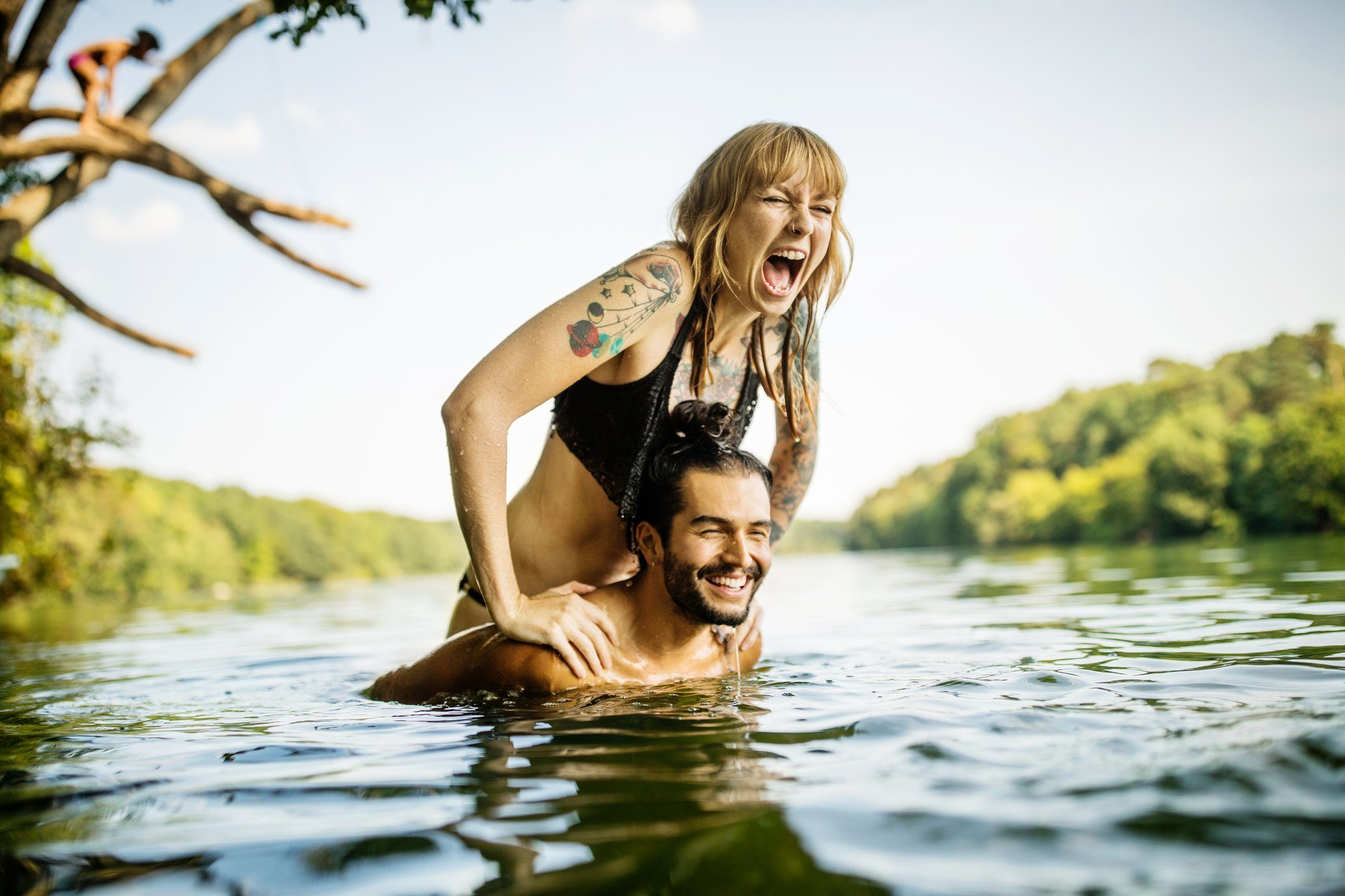couple having fun in the lake