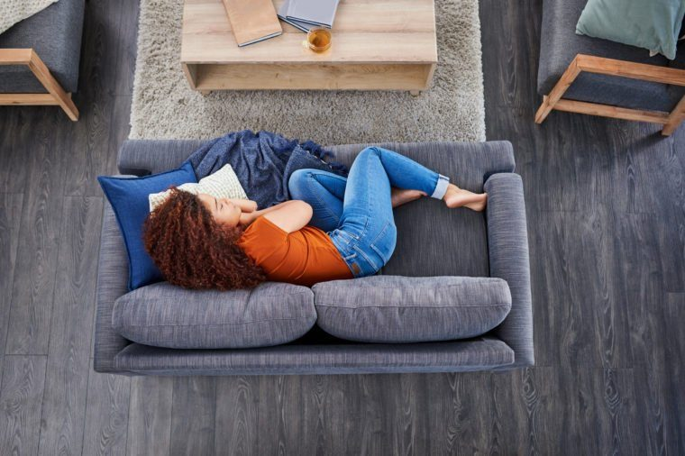 Woman sleeping in couch at home