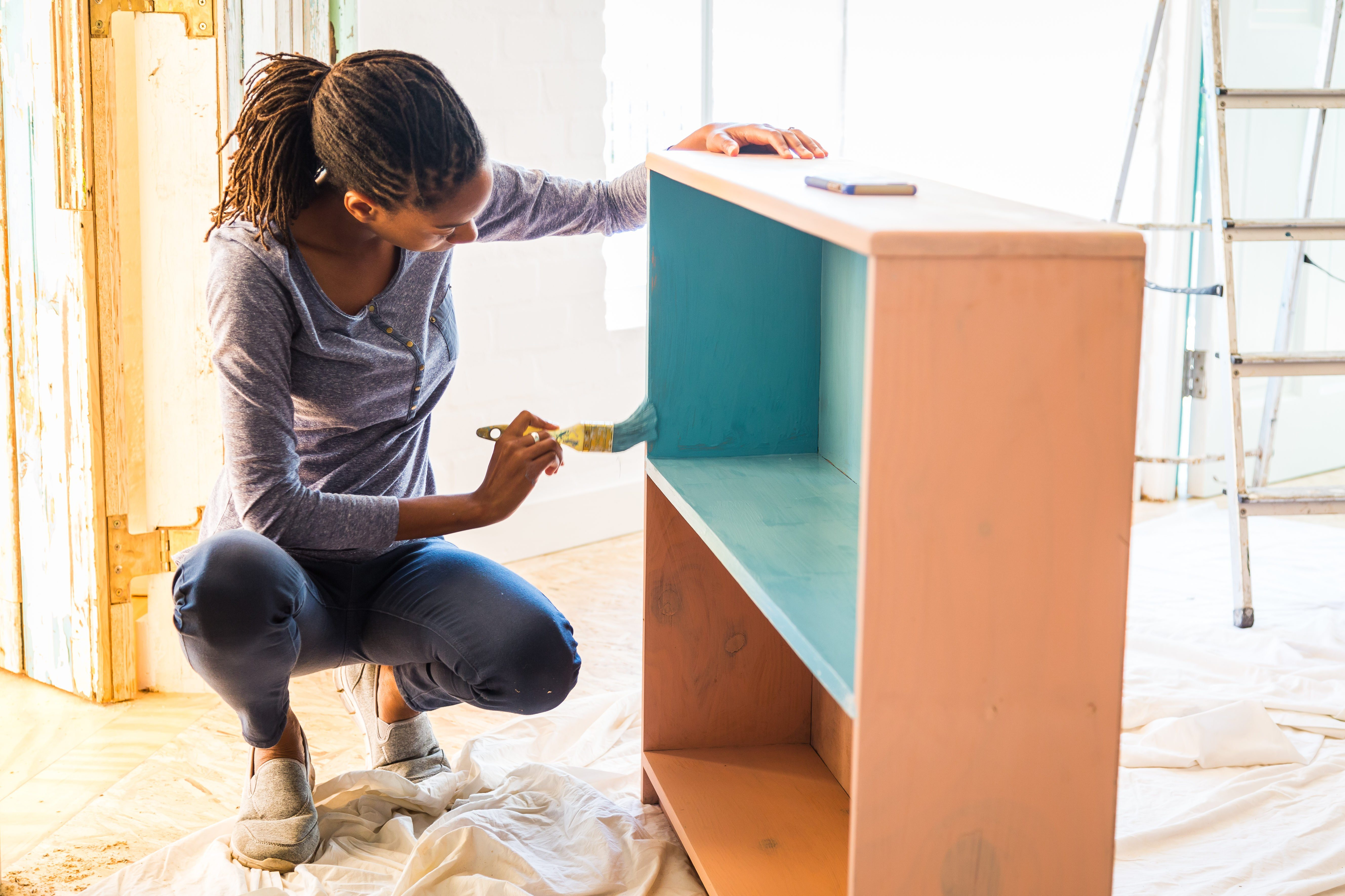 Young woman renovating her home