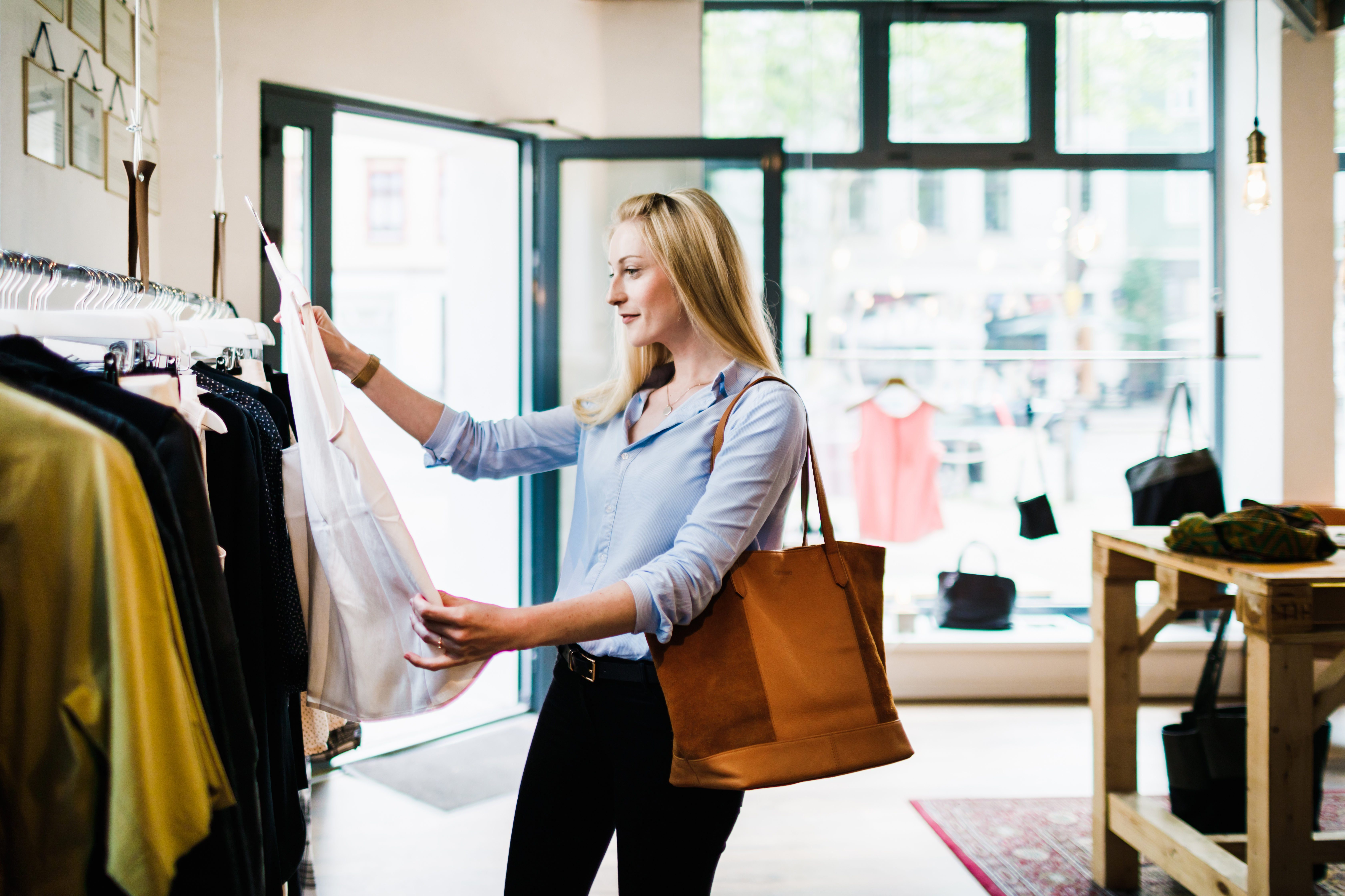 Woman Looking At Blouse While Shopping For The Day