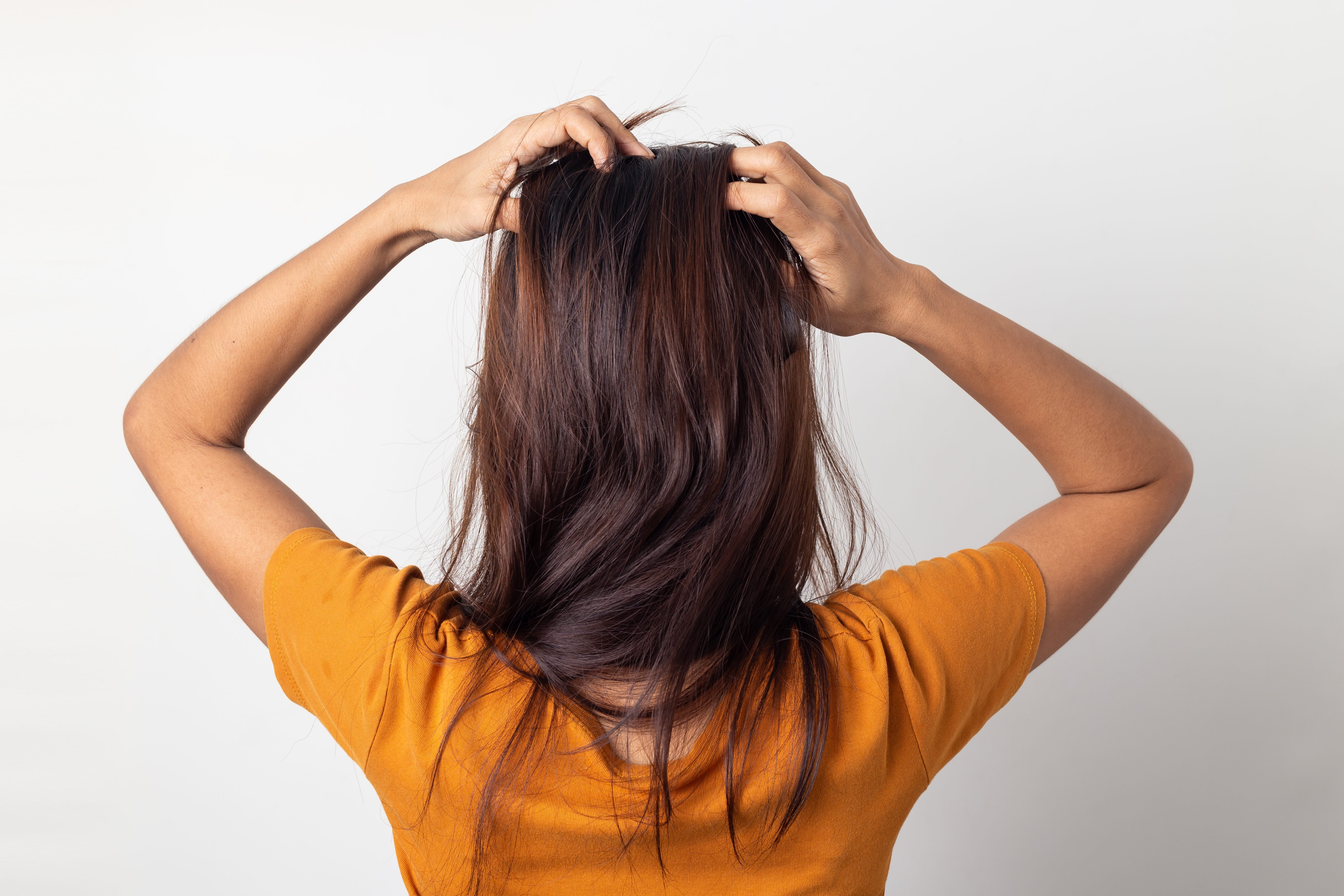 Women itching scalp itchy his hair and was massage her hair on a white background,Haircare concept