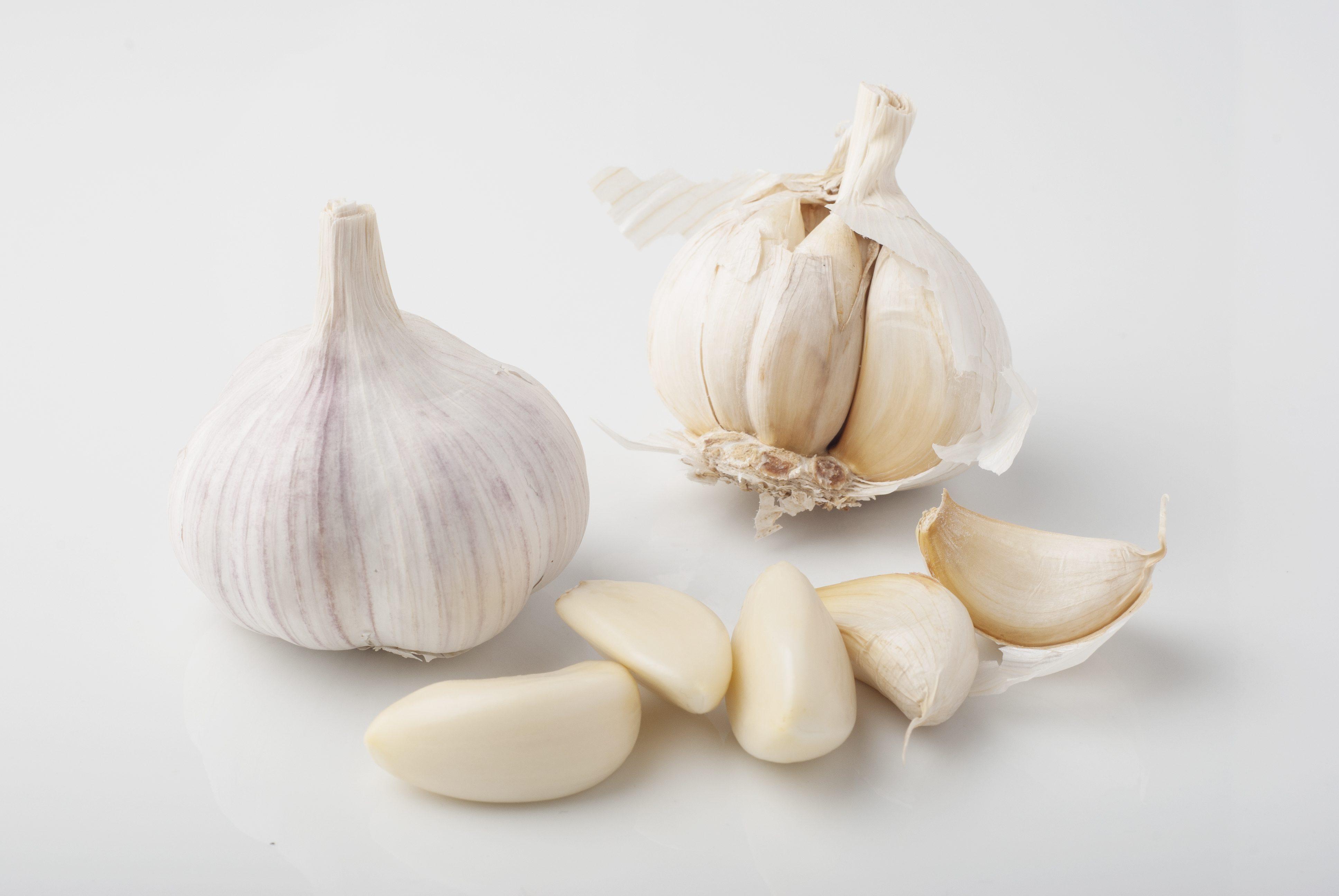 Close-Up Of Garlic On White Background