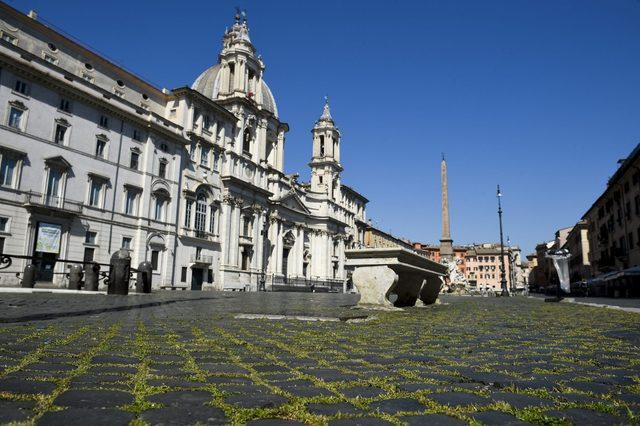 Unusual grass grows through the cobblestones in Piazza...