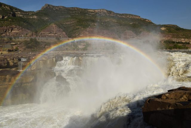 Rainbow Bridge Appears in Hukou Waterfall of The Yellow River