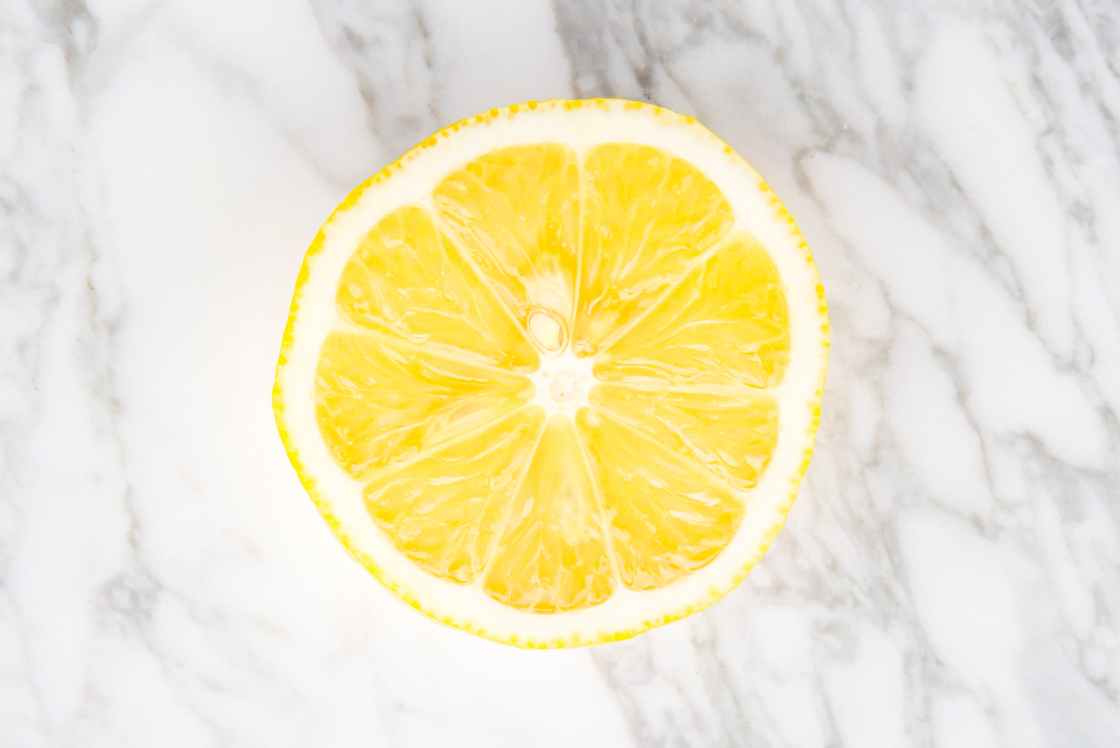 Lemon on gray marble