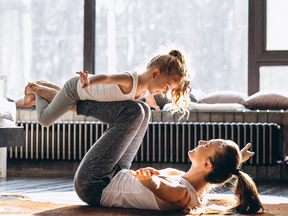 Mother and daughter at-home fitness