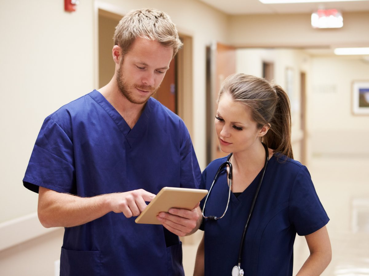 Male nurse speaking with his female colleague