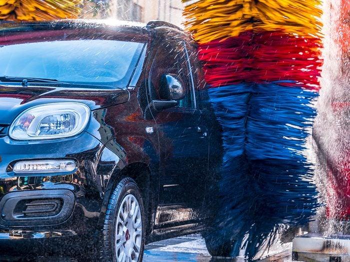 Car wash pros and cons - Car going through an automated car wash machine