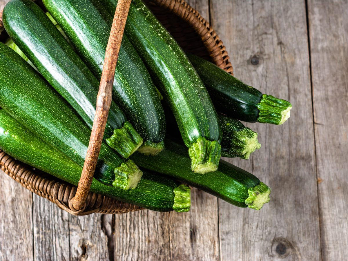 Zucchinis in brown wicker basket
