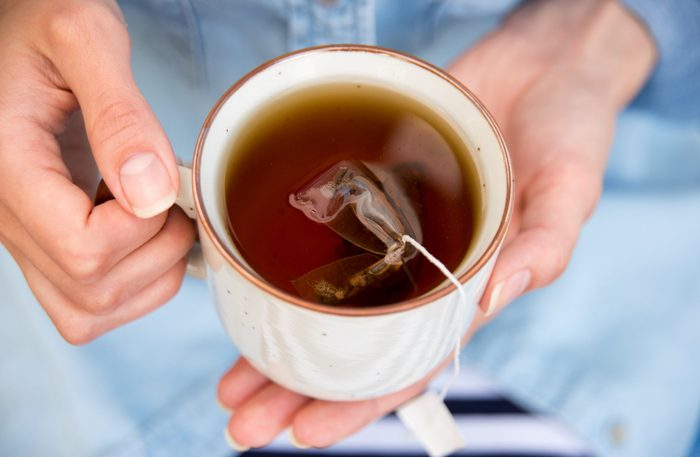 Home remedies for hemorrhoids - Woman Holding a Warm Cup of Freshly Brewed Tea