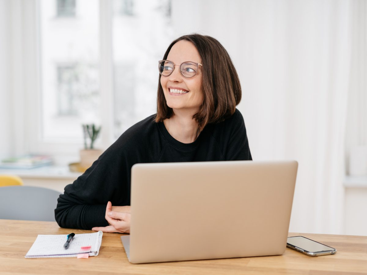 Female businesswoman smiling in home office
